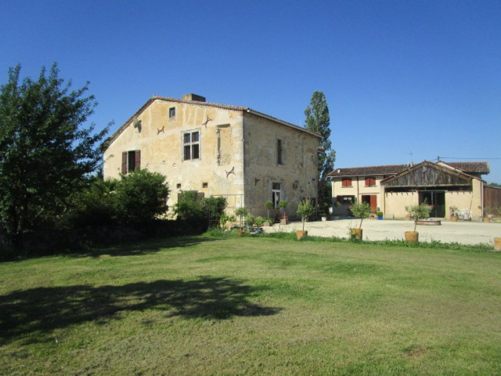 Beautiful stone-built character property with lake, pool, gite and 11 hectares (approximately 27 acres) of grounds including 10 acres of woodlands and a schooling arena of 30mx20m.